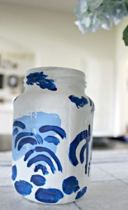 Do you want an ginger jar collection, but only have mason jars? No problem! DIY these mason jars turned ginger jars with a little blue & white paint & some Chinoiserie inspiration!