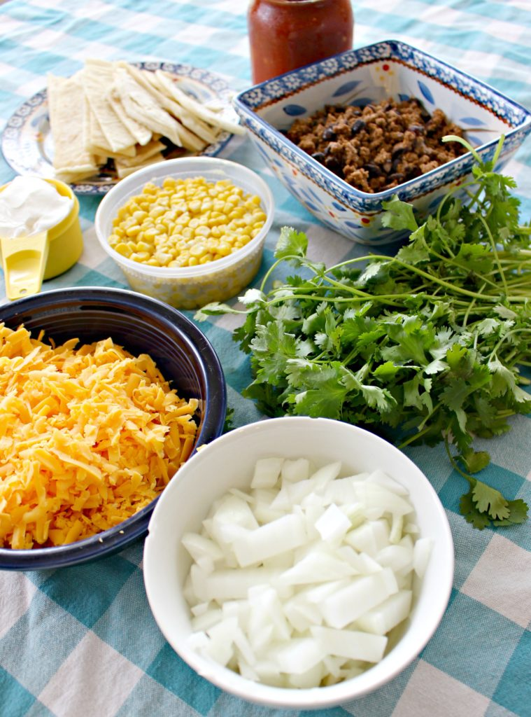 Mix up Taco Tuesday with this delicious Taco Casserole! It's a crowd-pleasing, easy, week-night dinner! It makes a greta freezer meal too!