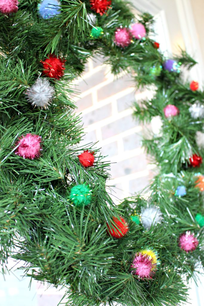 Need a Quick Christmas Wreath? Make a Pom Pom Wreath in No Time at All! #ChristmasCrafts #ChristmasWreath