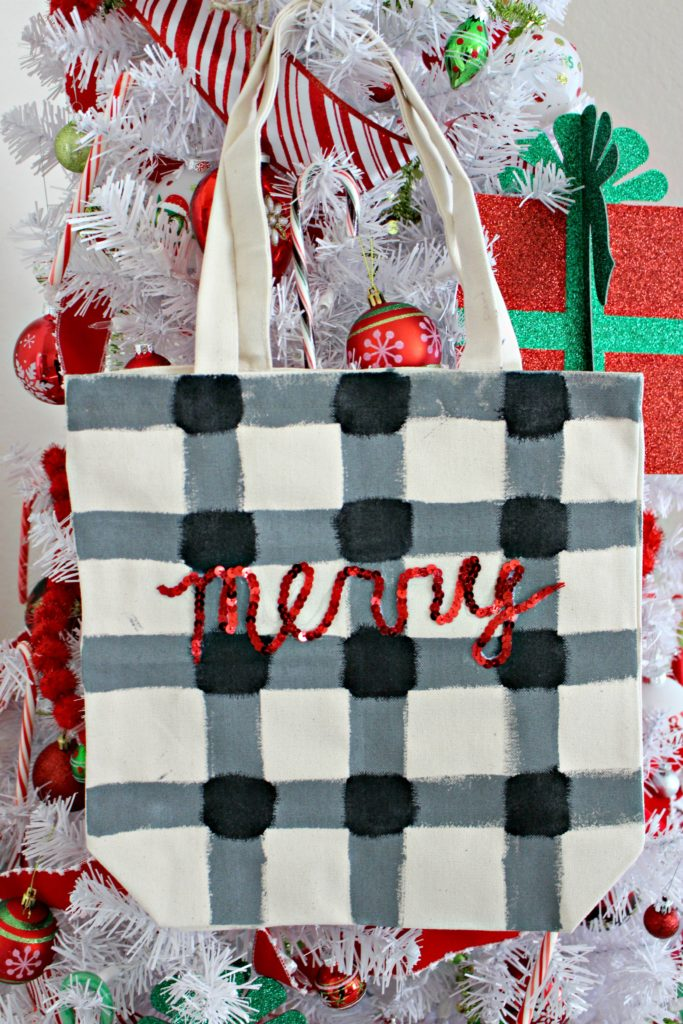 Paint a buffalo plaid tote for extra special gift wrap! Or use it all season long to carry things from place to place. #HobbyLobbyFinds #HobbyLobbyMade #ad